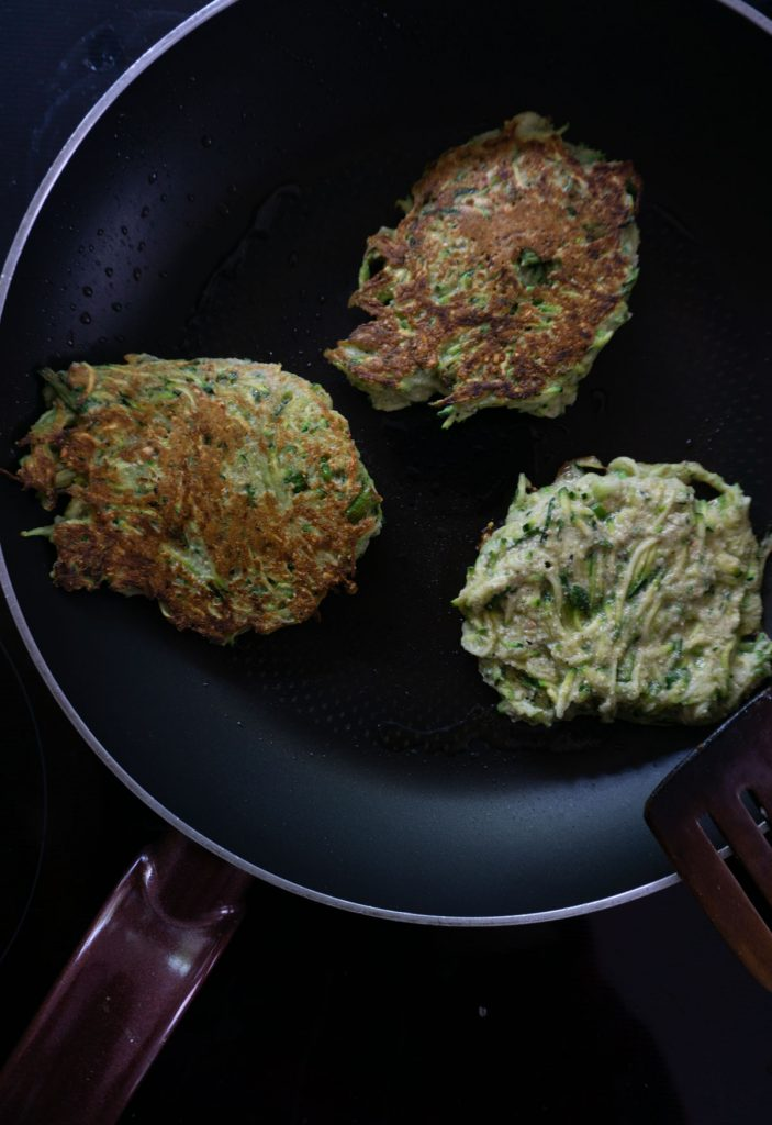 Courgette fritters in the pan