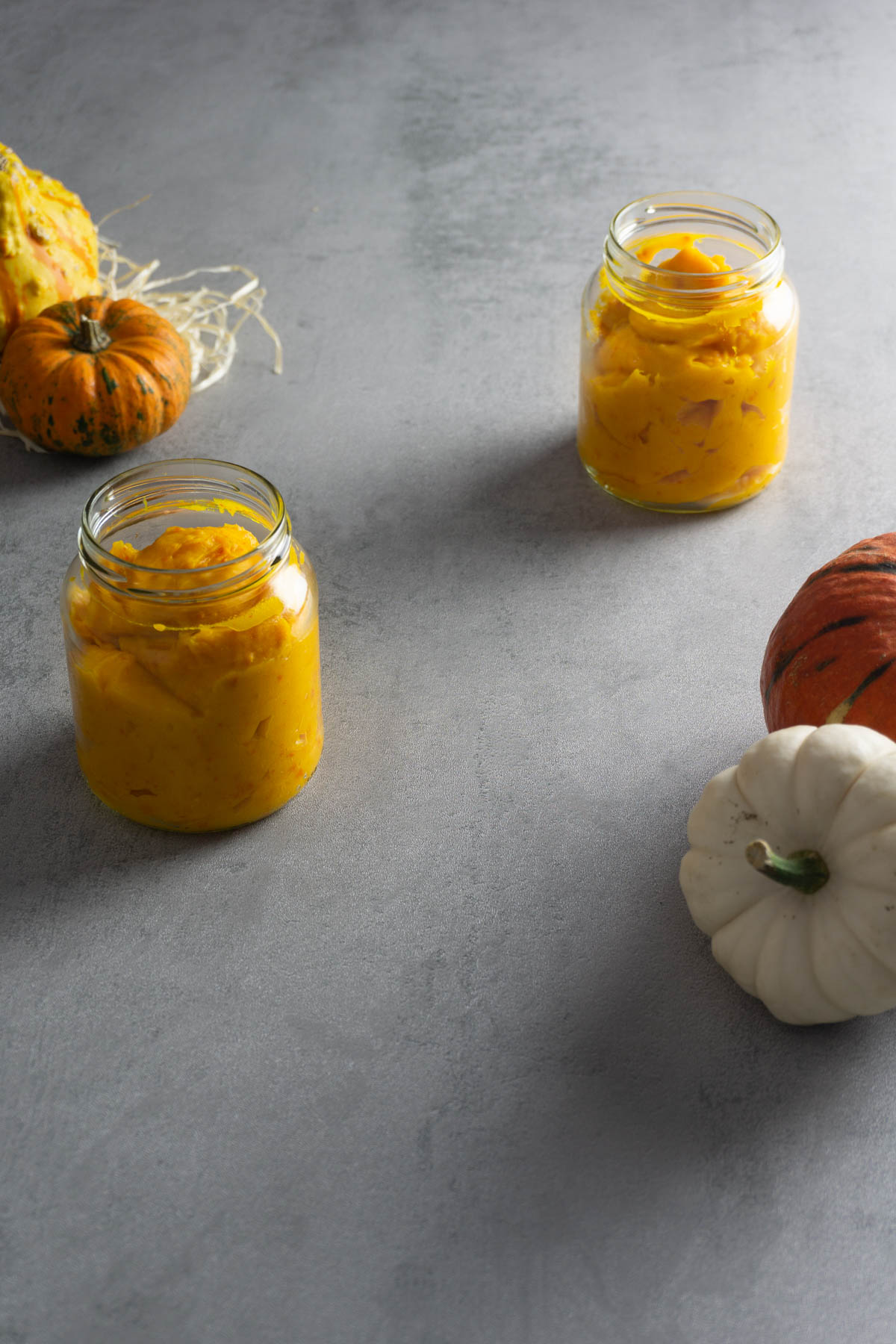 Pumpkin Puree set out with pumpkins in two glasses