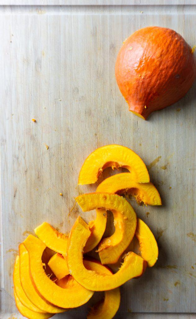 Pumpkin cut up on a chopping board