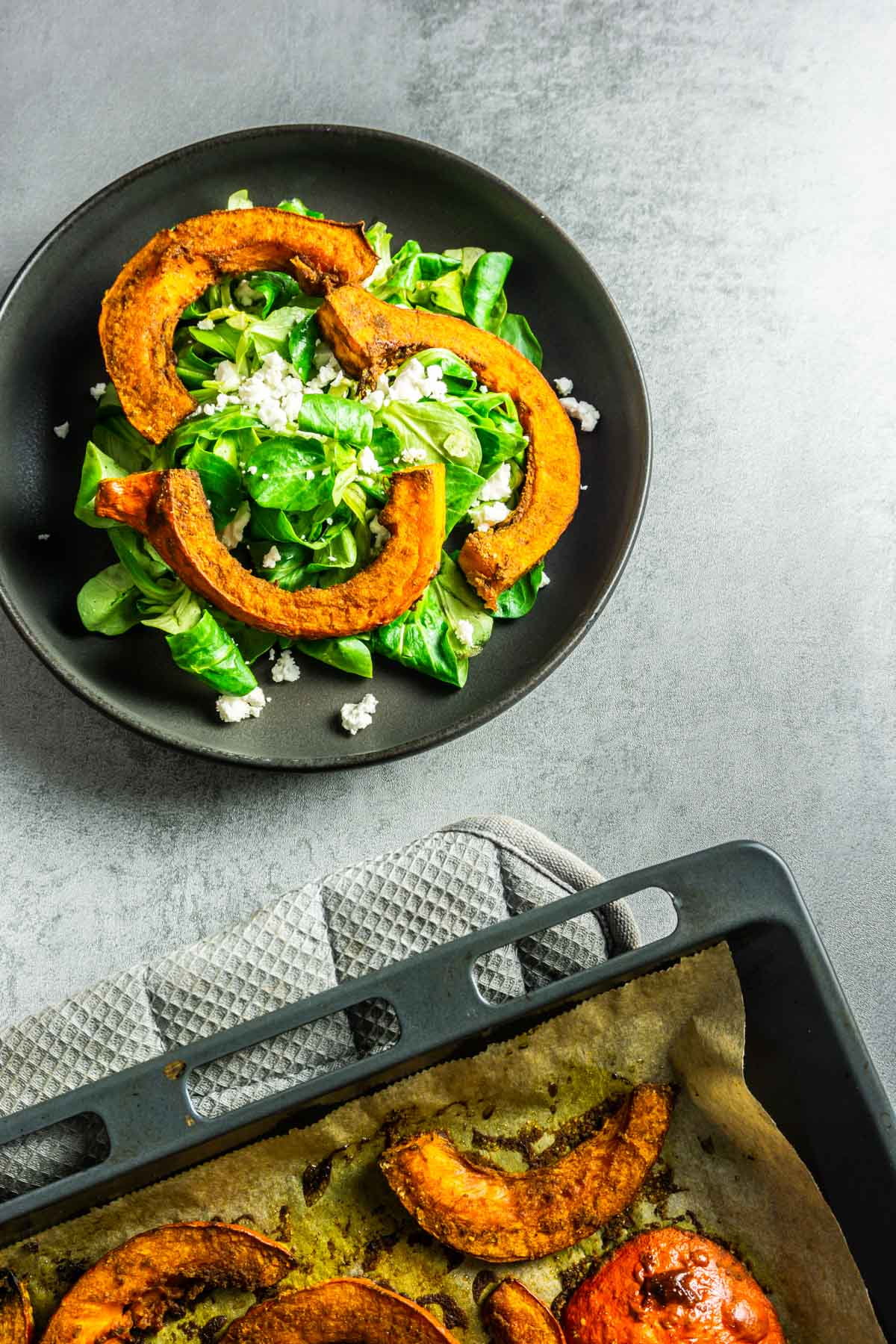 Baked spiced pumpkin on lambs lettuce with feta