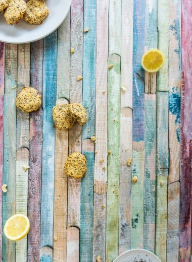 Lemon Chia Cookies on a plate and on a colored surface