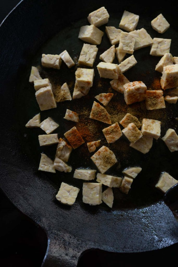 Tempeh with spices in pan