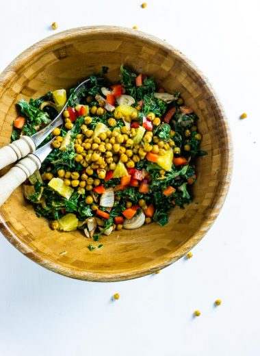 Creamy Kale salad in a bowl with salad tongs