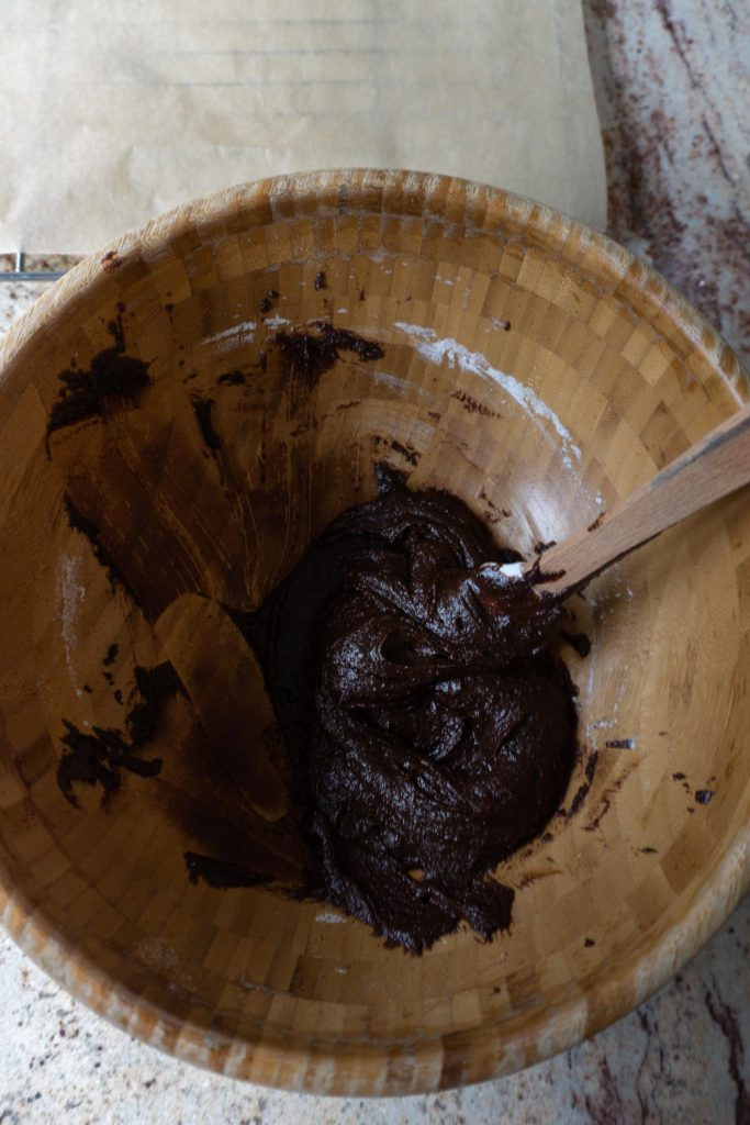 Mixing a chocolate sauce with coconut sugar, coconut flour and baking powder