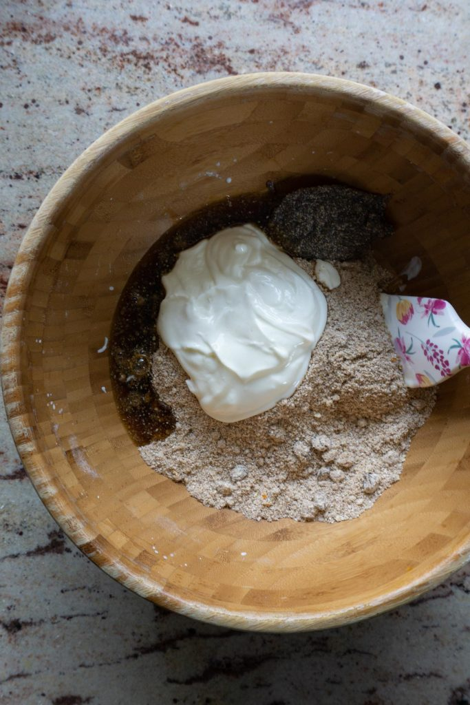 Adding yogurt, maple syrup, and chia egg to dry ingredients