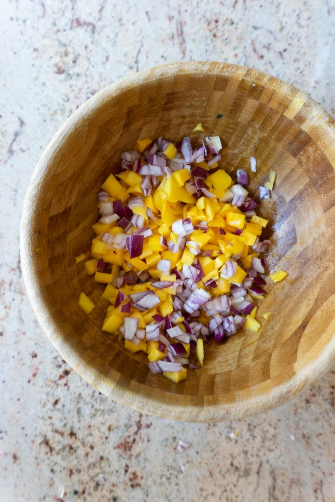 Chopped Mango and finely cut onion in a bowl