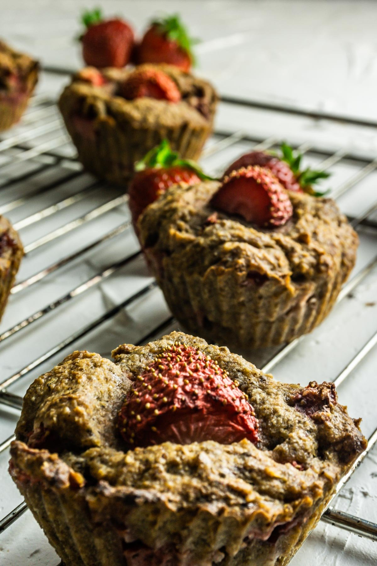 Strawberry Banana Muffins on a wired rack