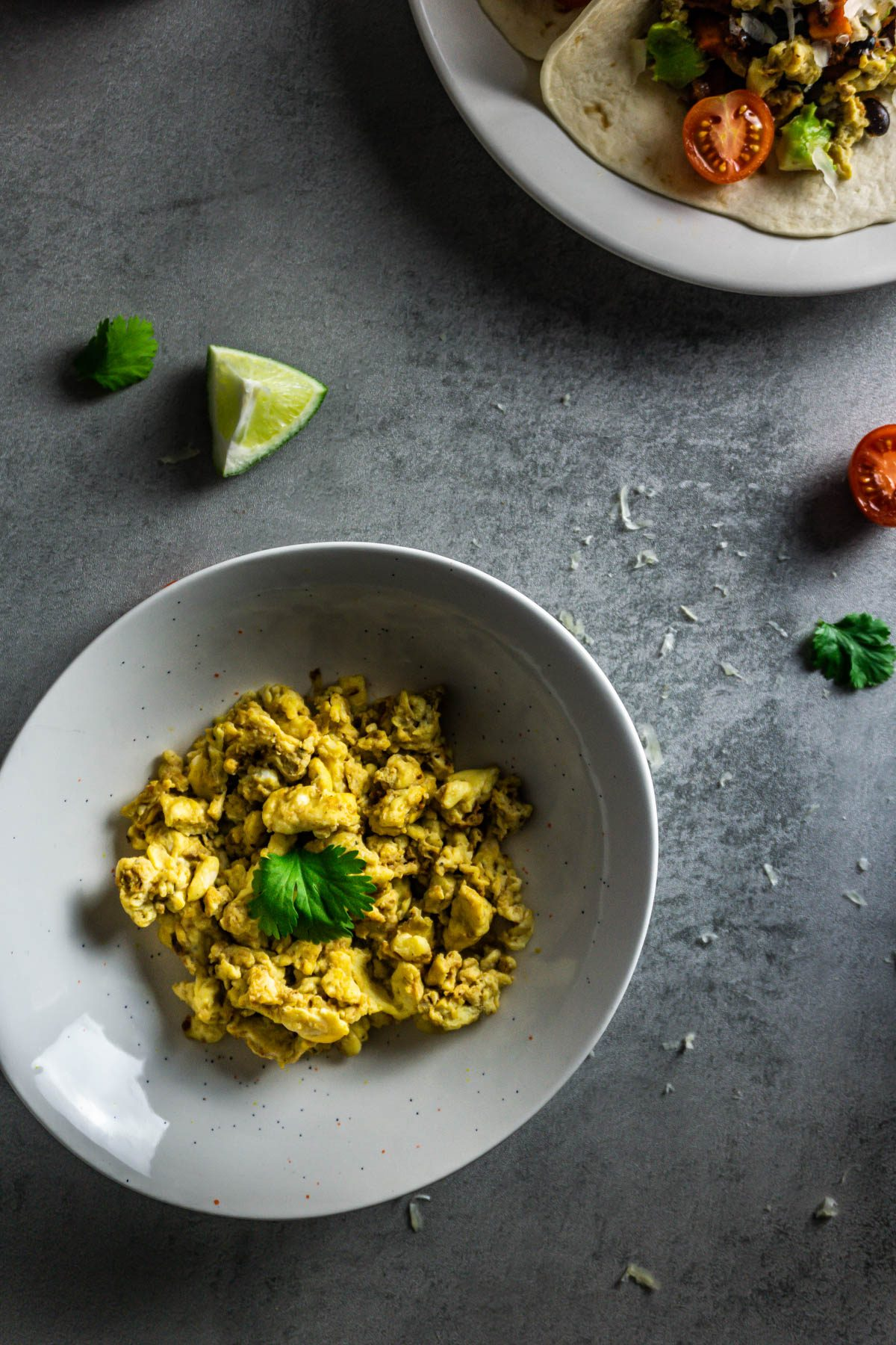 Scrambled eggs for Breakfast Tortillas on a grey background