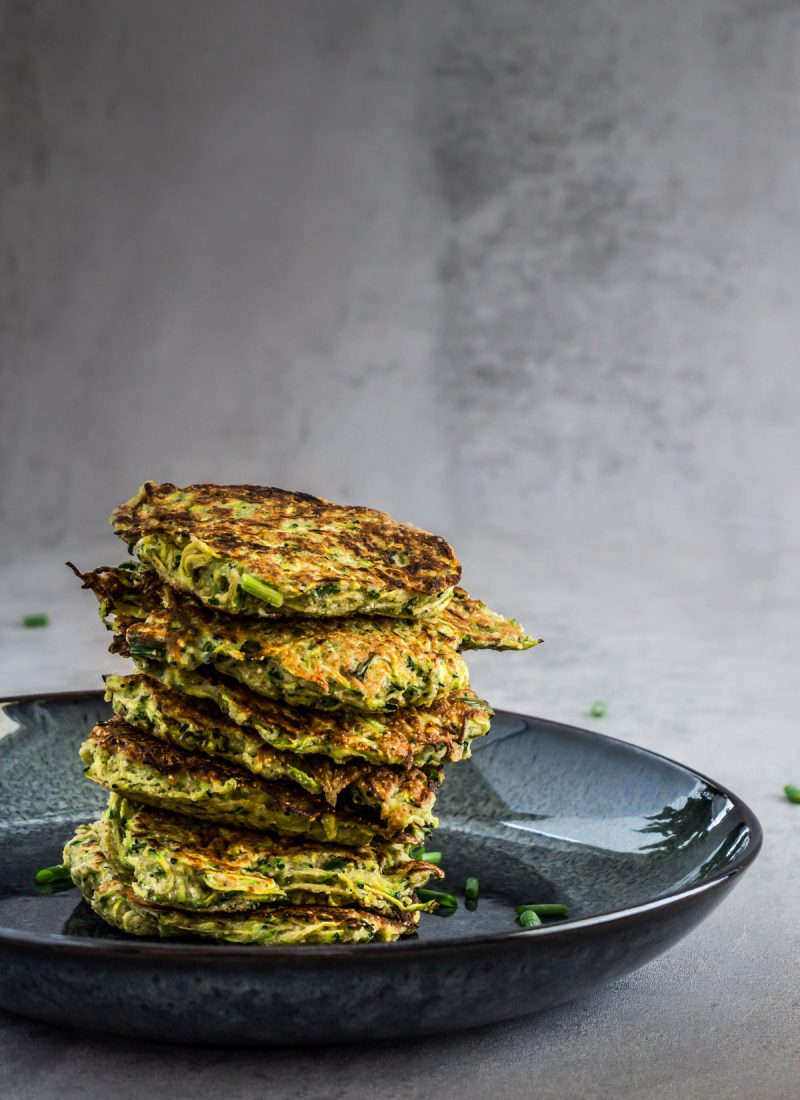 Courgette Fritters on a grey background