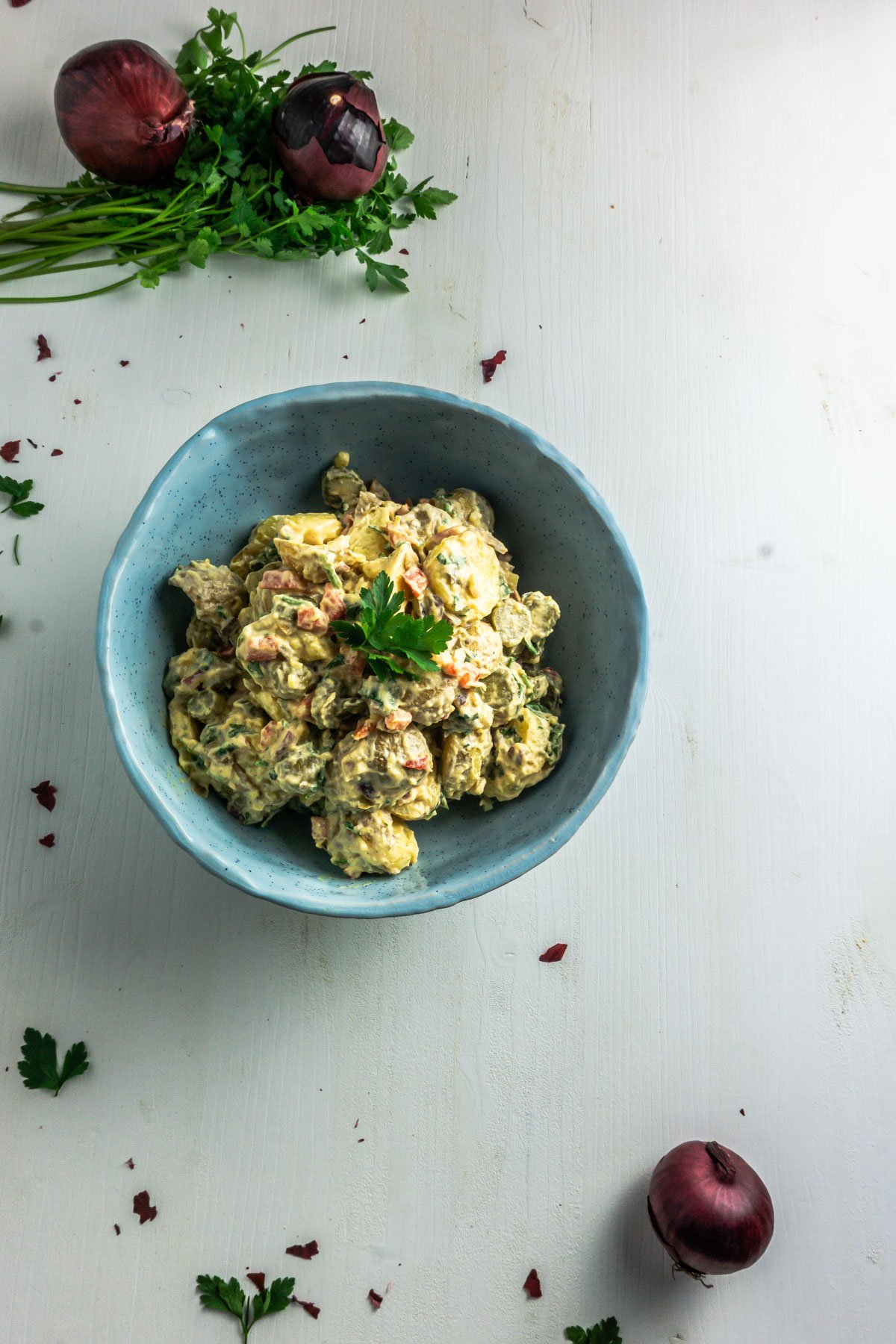 Vegan Potato Salad in a bowl on a white background