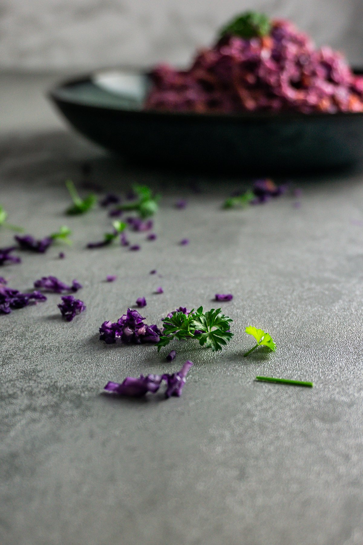 Shredded purple cabbage and parsley with Easy Purple Coleslaw in the background