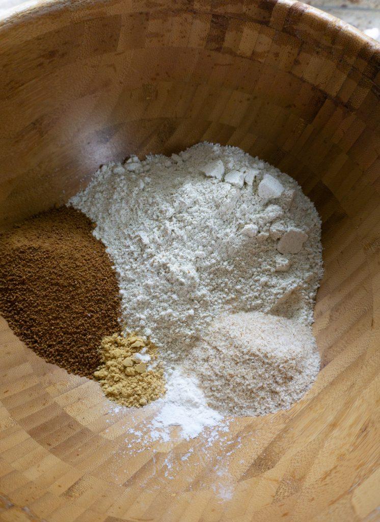 Gluten-free flour, coconut sugar, ground ginger, psyllium husk and baking powder in a bowl