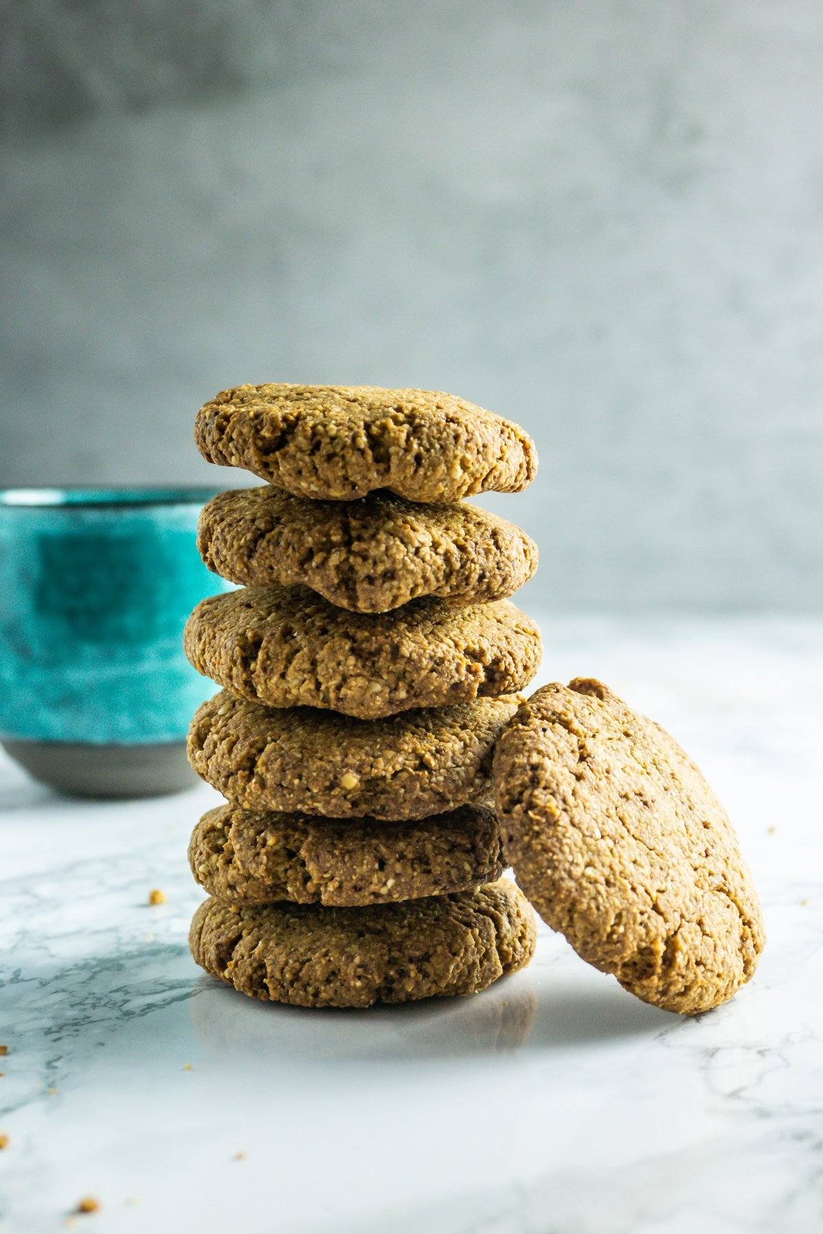 Stacked Crunchy Ginger Cookies on a marble background