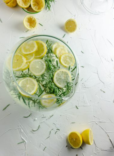 Summer Day Lemonade in a large pitcher with lemons on a white background