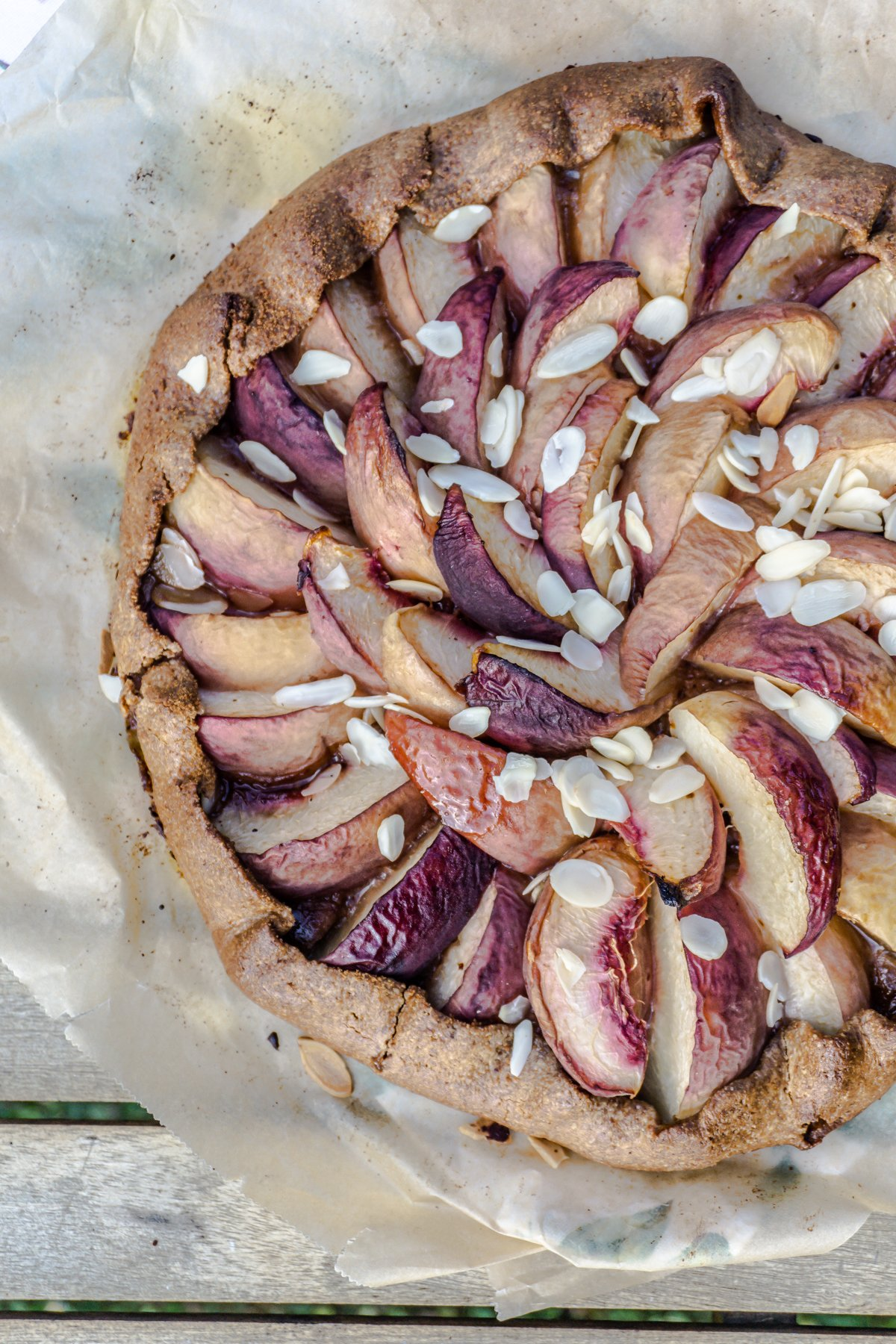 Peach Galette on a rustic table shot from above