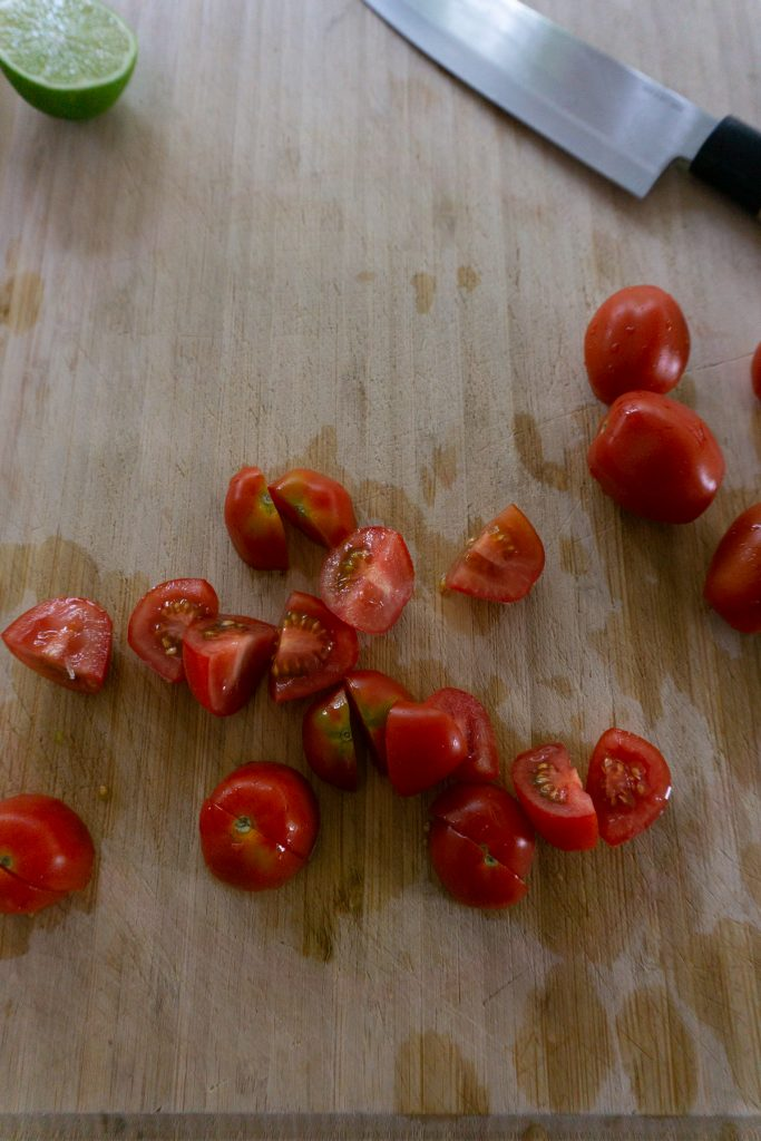 Cutting cherry tomatoes into quarters