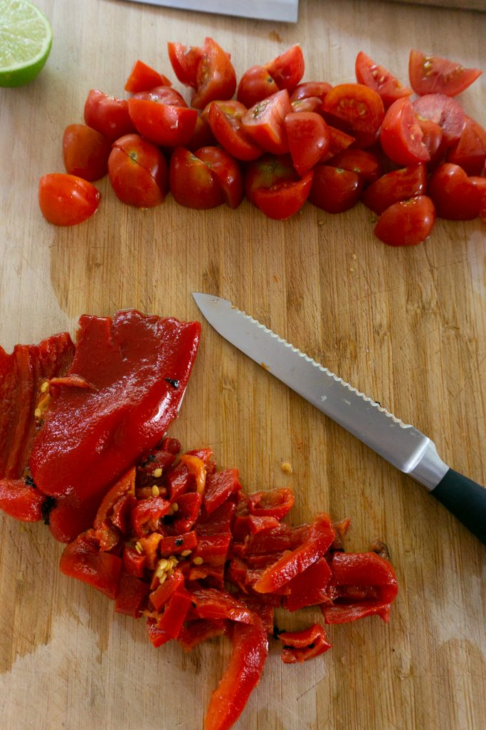 Chopping roasted red peppers