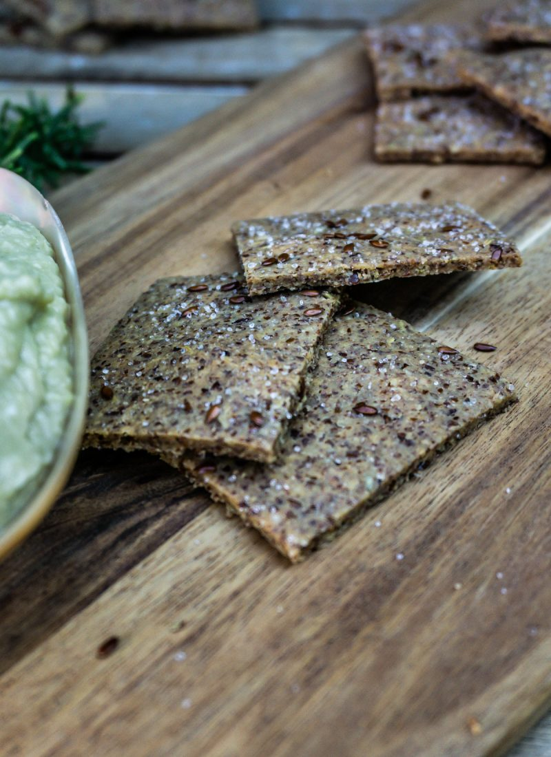 Easy Peasy Flax Crackers stacked on a wooden board