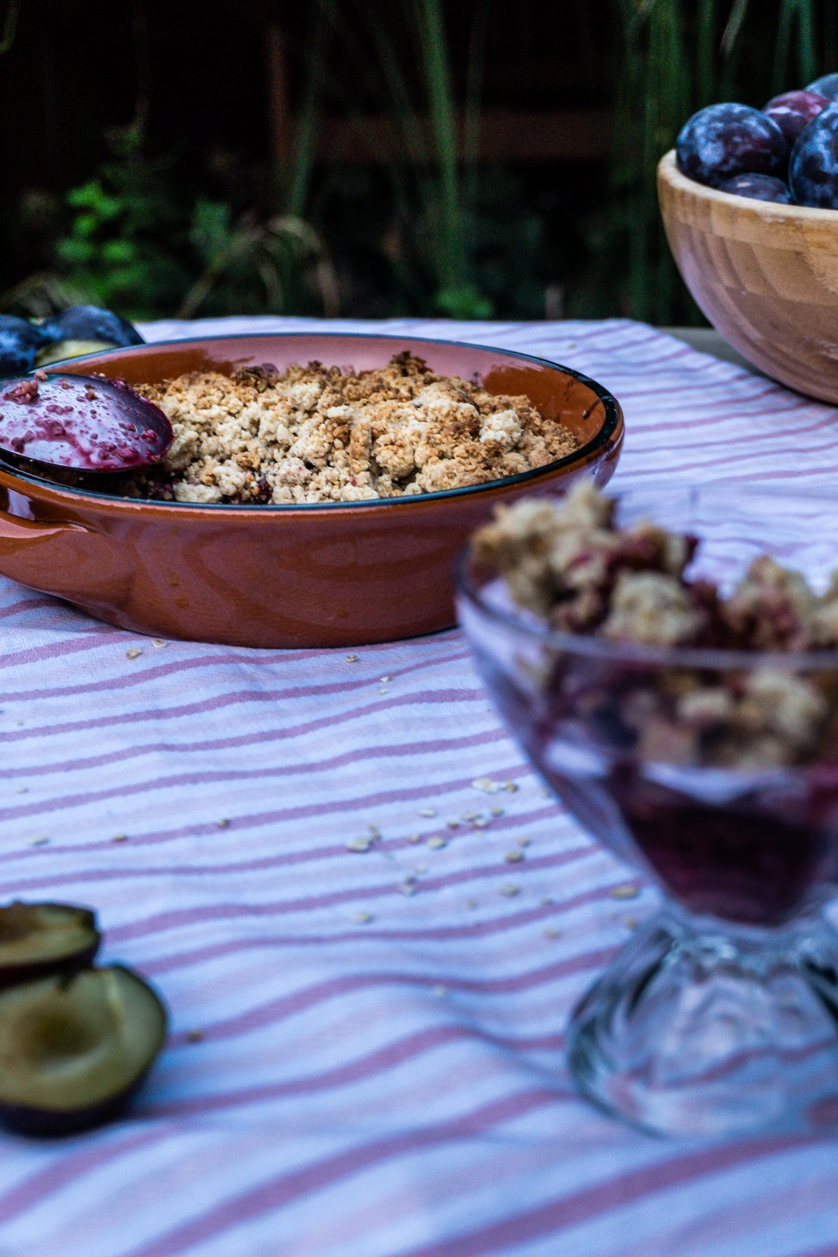 Baked Plum Crumble with a spoon in focus