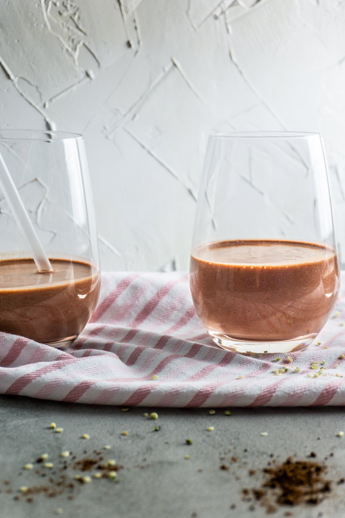Two Chocolate Beet Smoothies in a glass shot from the front