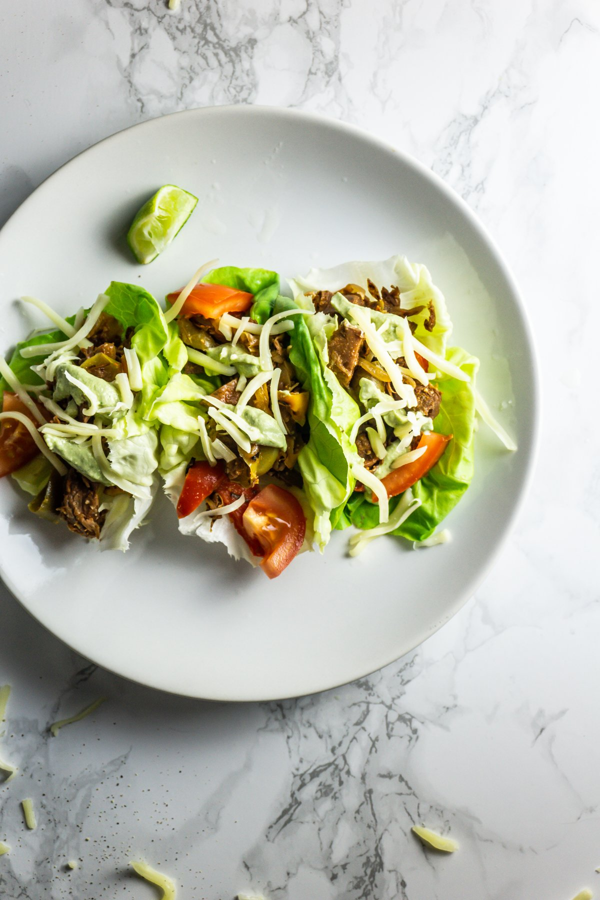 Mexican-Inspired Jackfruit Fajitas in lettuce wraps on a plate shot from above