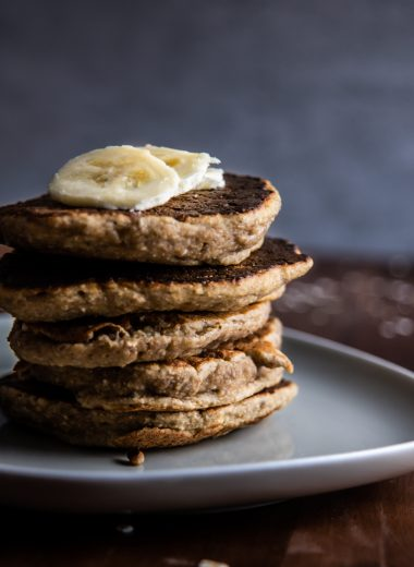Stacked Easy Pantry Staple Pancakes with sliced bananas on top