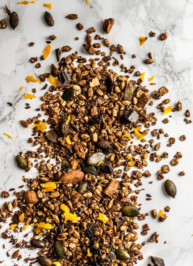 Chocolate Orange Granola strewn on a marble background