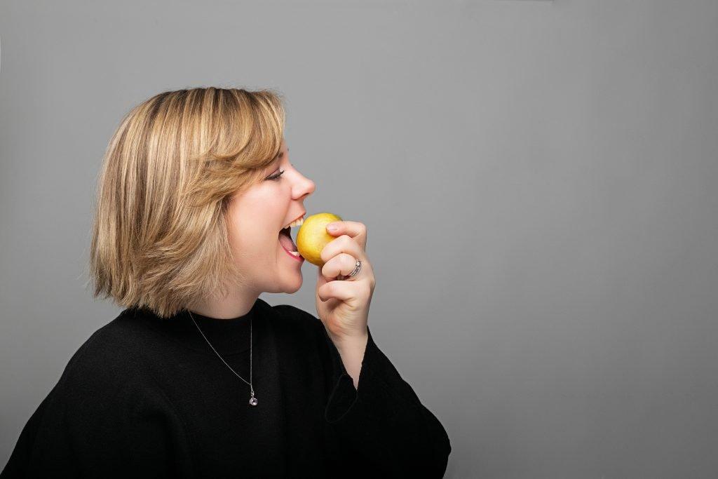 About me - Ann-Christin Robejsek biting into a lemon