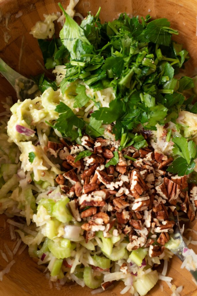 Adding chopped pecan nuts and parsley to my Moster-in-Law's Apple Celery Salad