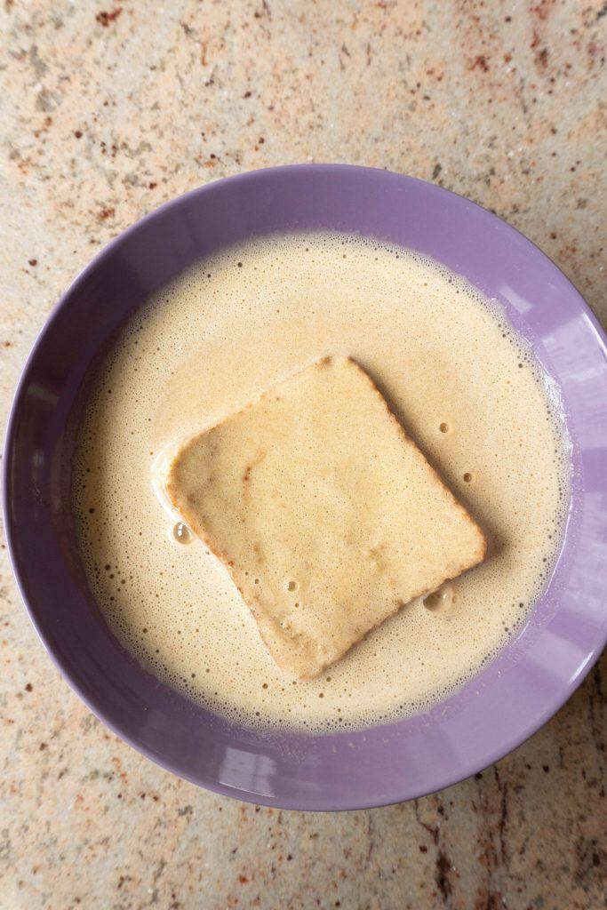 Toast soaking in Cinnamon Banana French Toast batter