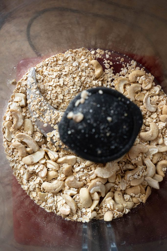 Oats and cashews in a food processor