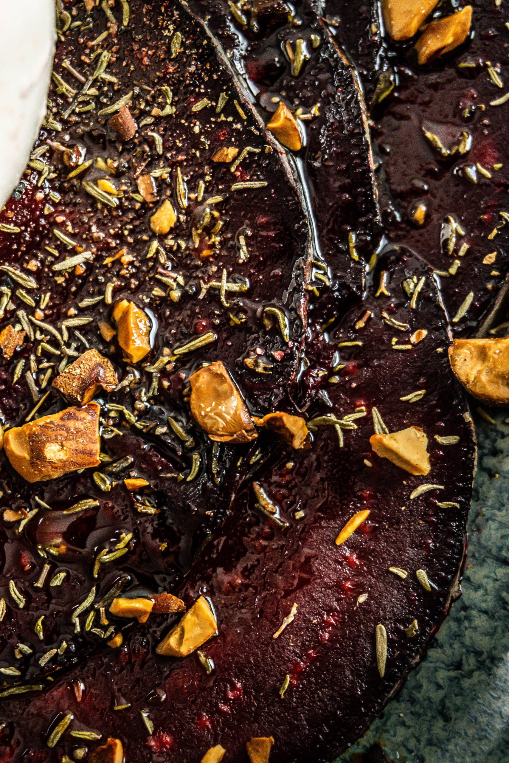 Sliced beetroot with thyme and chopped almonds on top