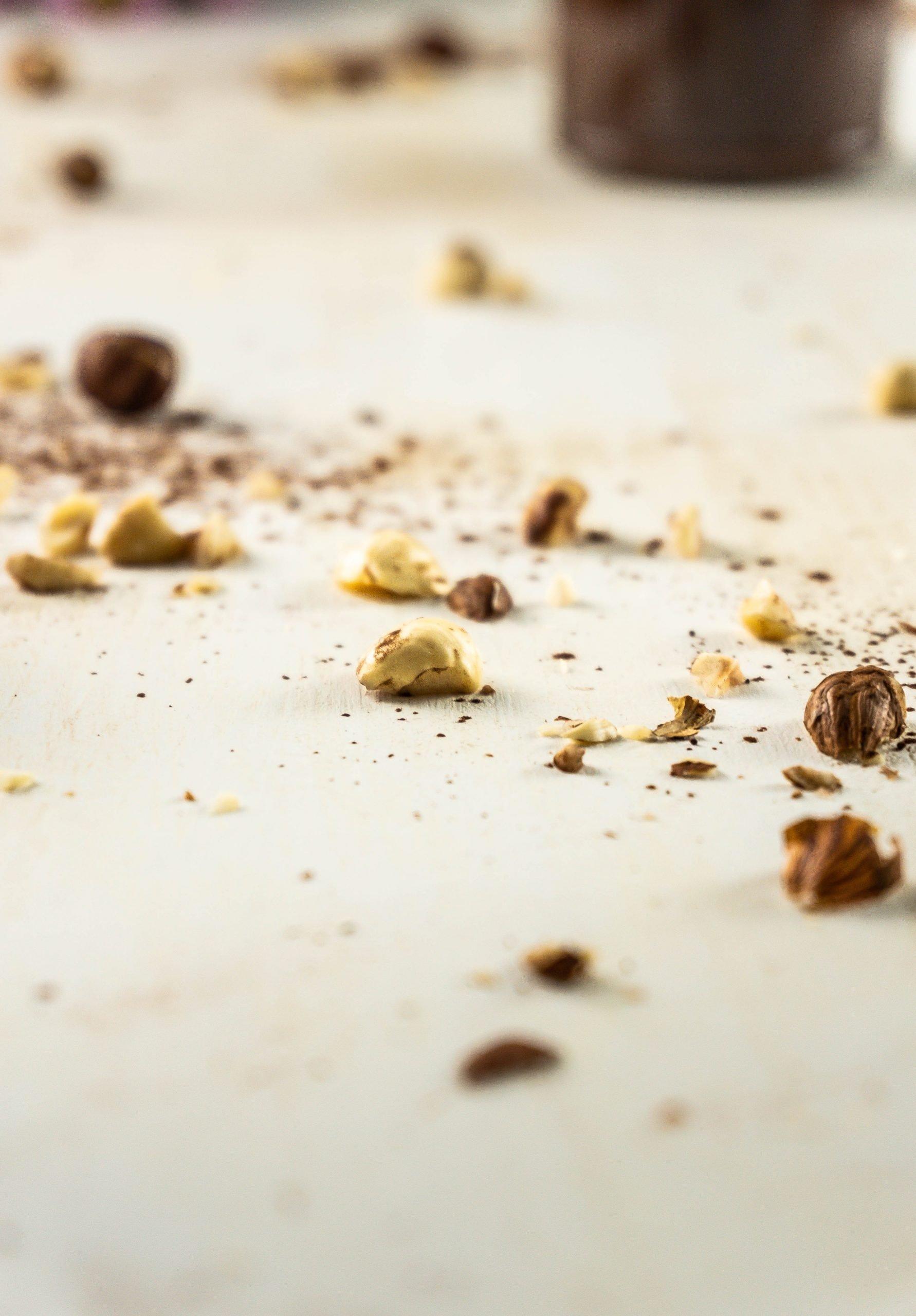 Chopped hazelnuts on a white background