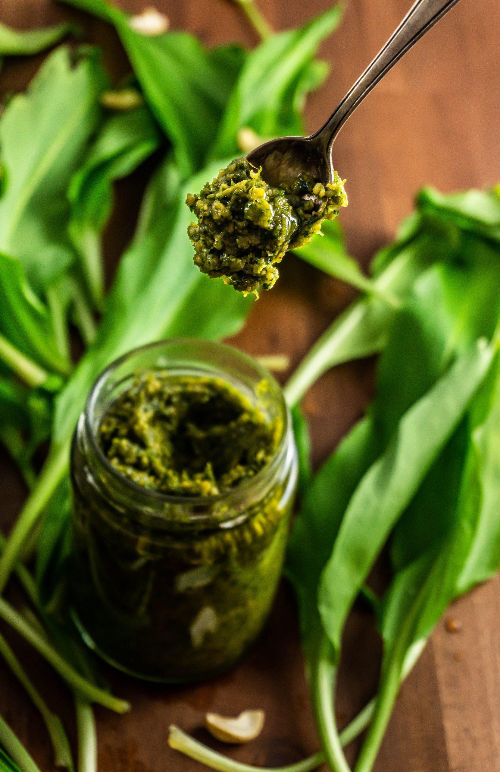 Easy Vegan Wild Garlic Pesto on a spoon held into focus