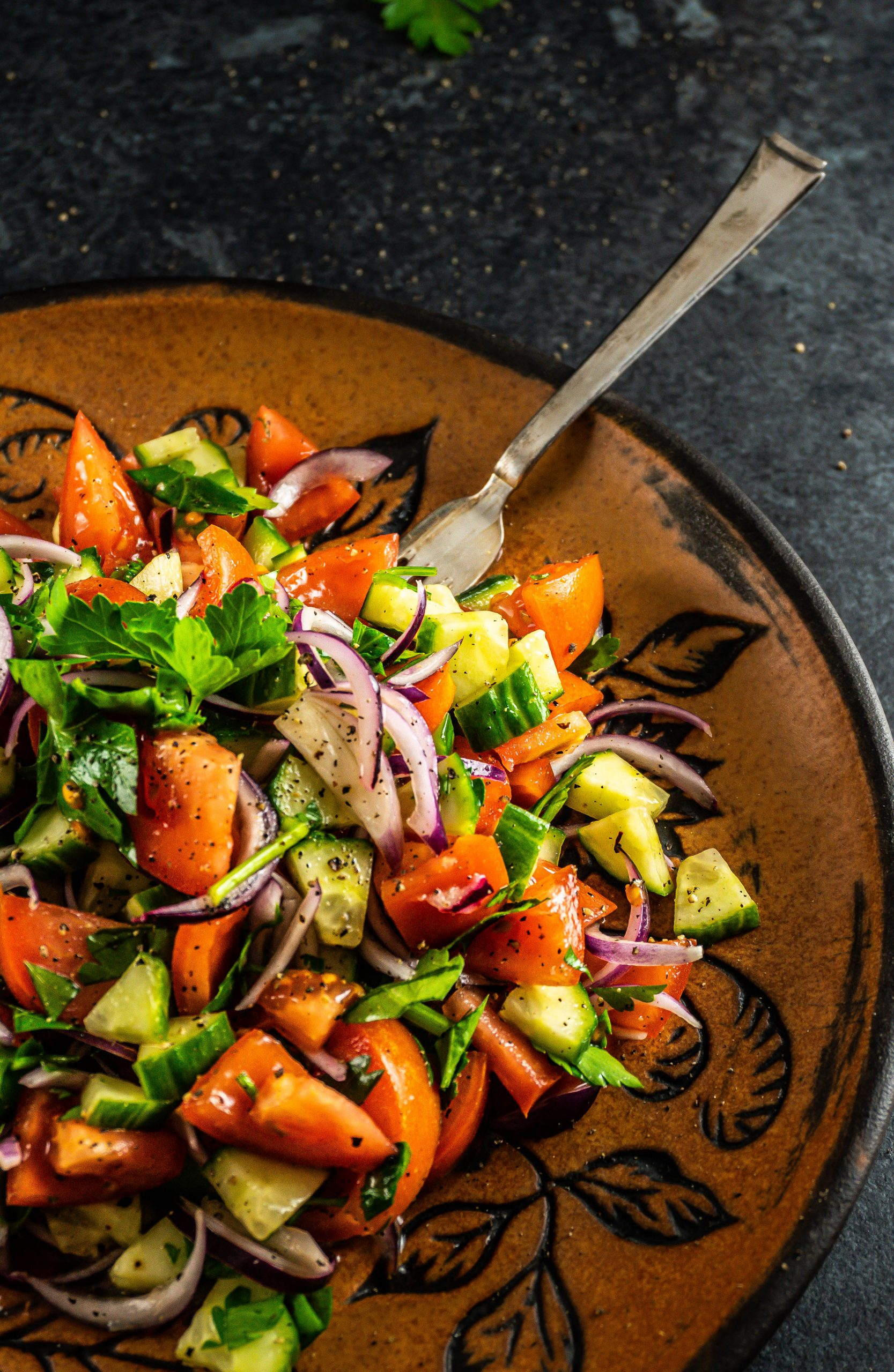 Easy, Simple Summer Salad on a large plate with a dark background