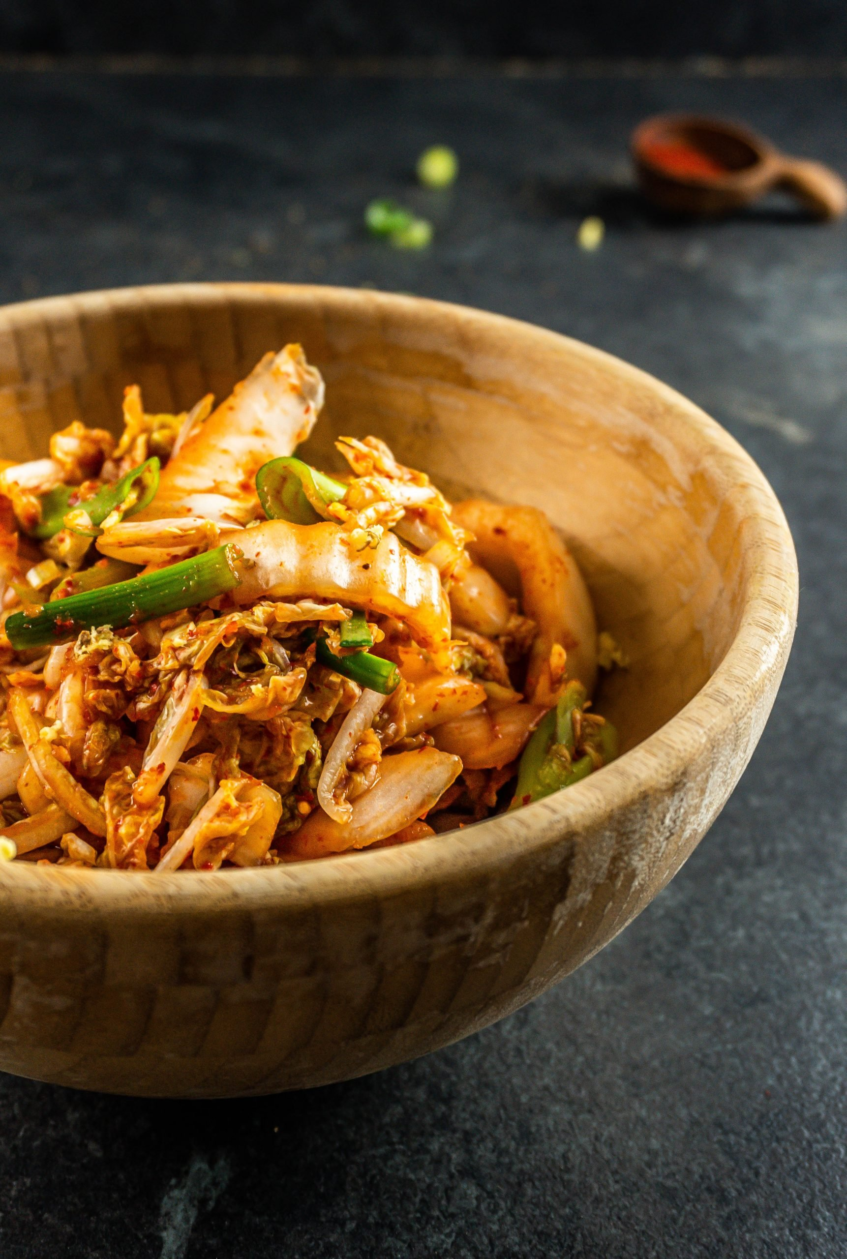 Delicious Vegan Kimchi in a wooden bowl photographed from a three-quarter angle