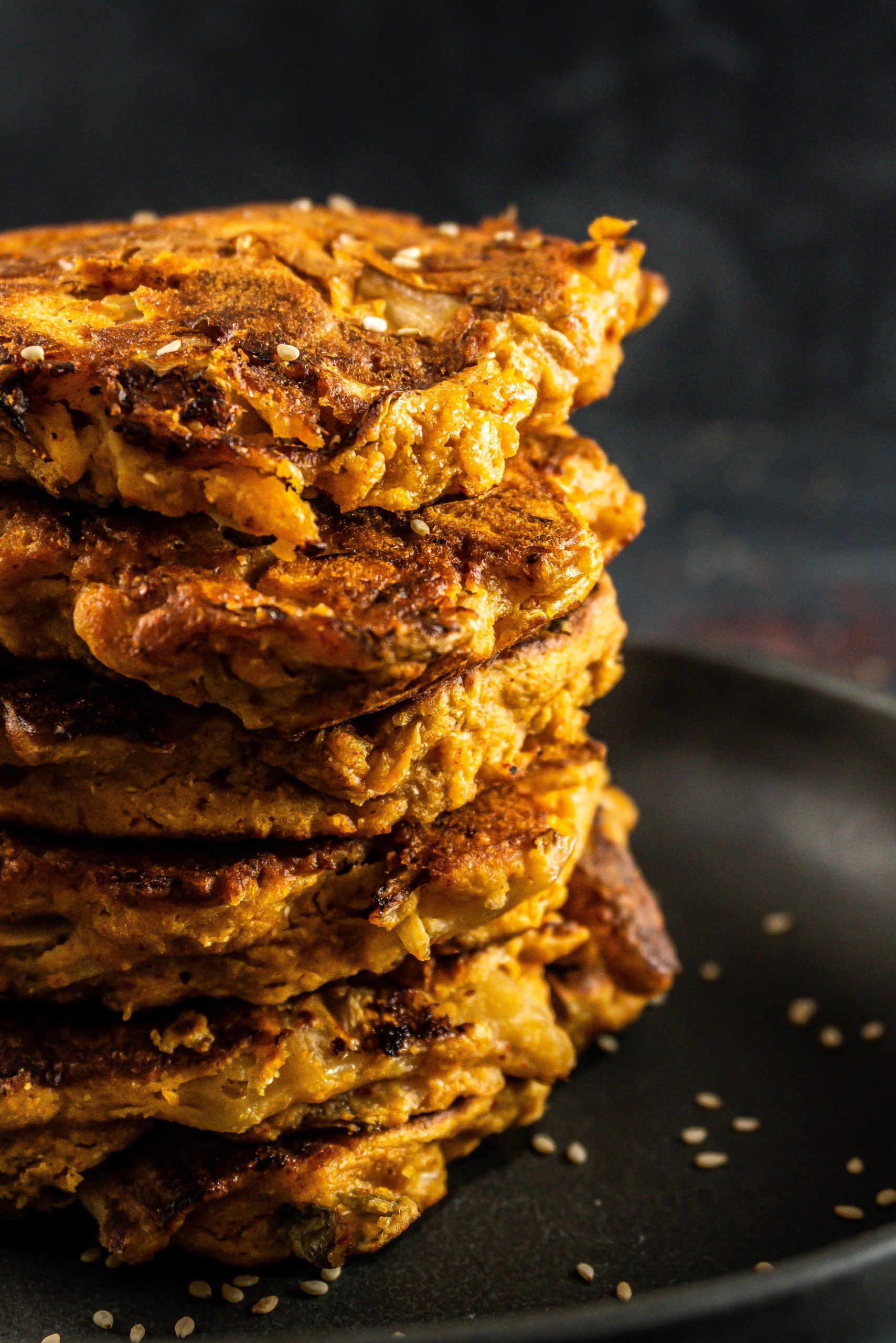 Korean-style Kimchi Pancakes (Kimchi Jeon) photographed as a close-up from the side
