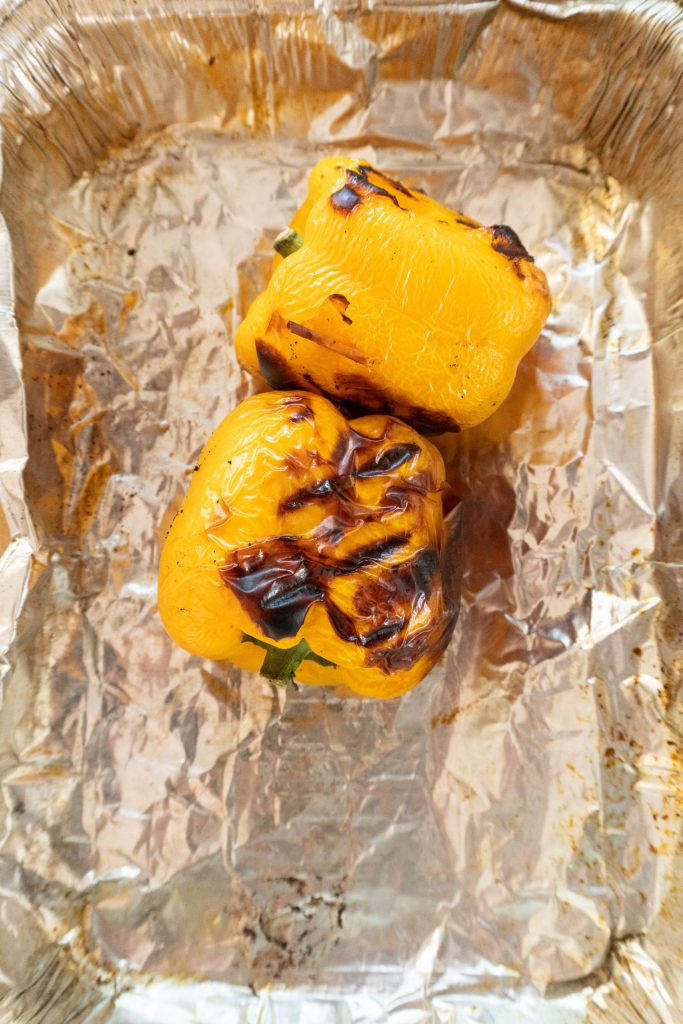 Charred yellow peppers in a silver tray