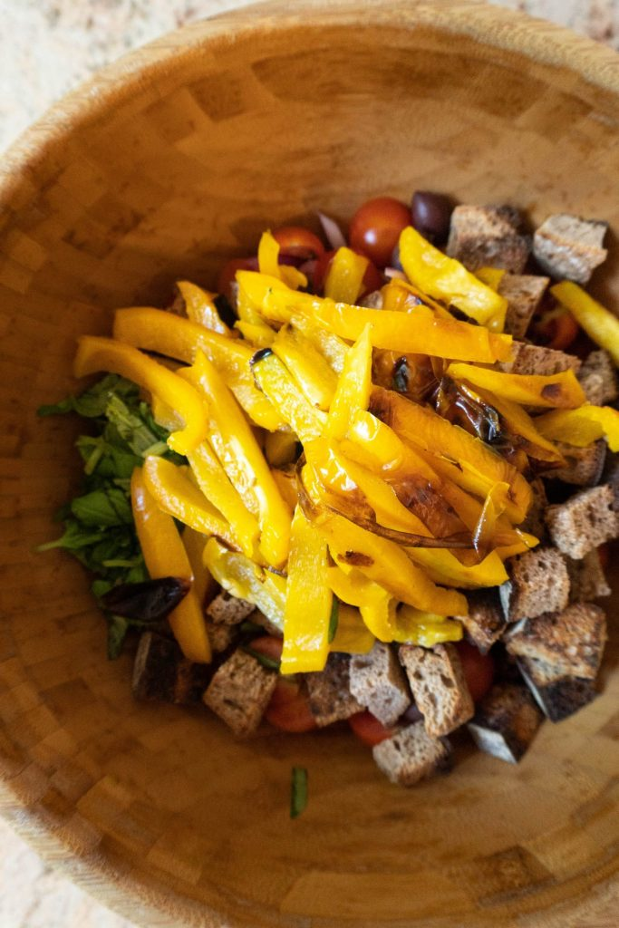 Tuscan-Style Bread and Tomato Salad (Panzanella) ingredients in a wooden bowl before adding sauce