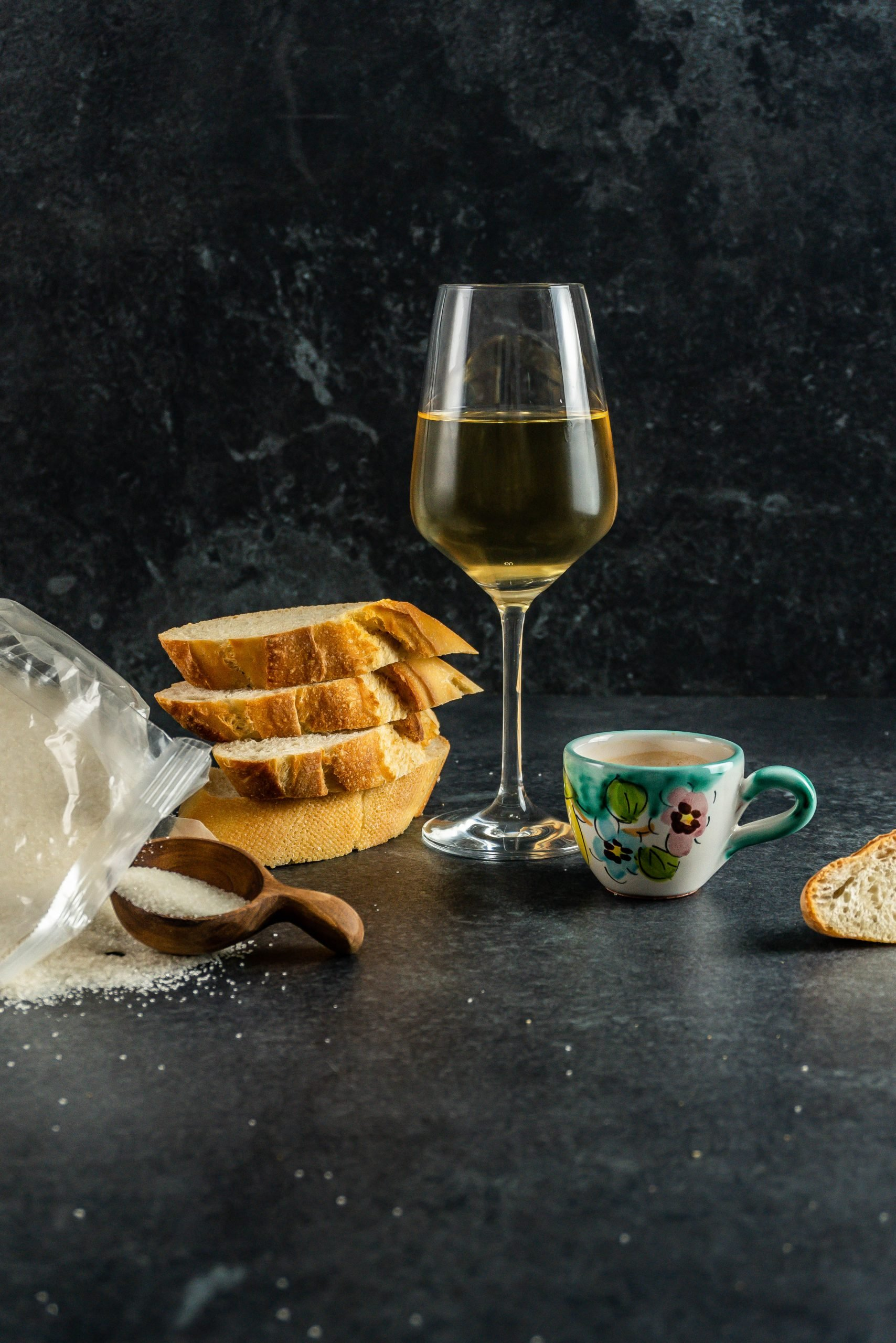 Sugar, white brad, alcohol, and coffee photographed together