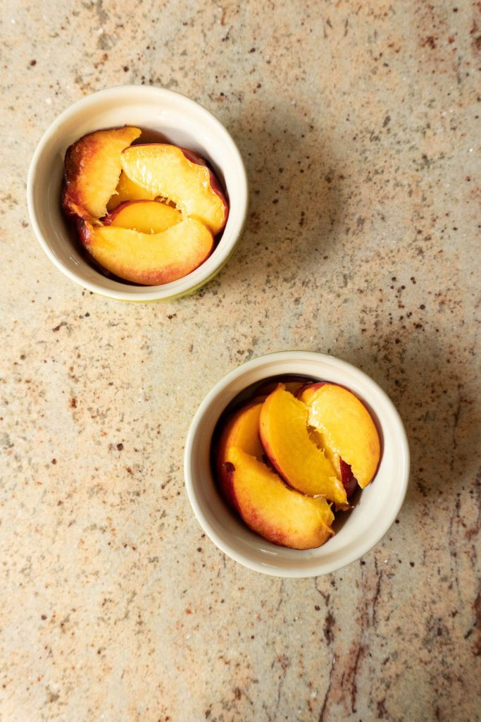 Sliced peaches in small ramekins