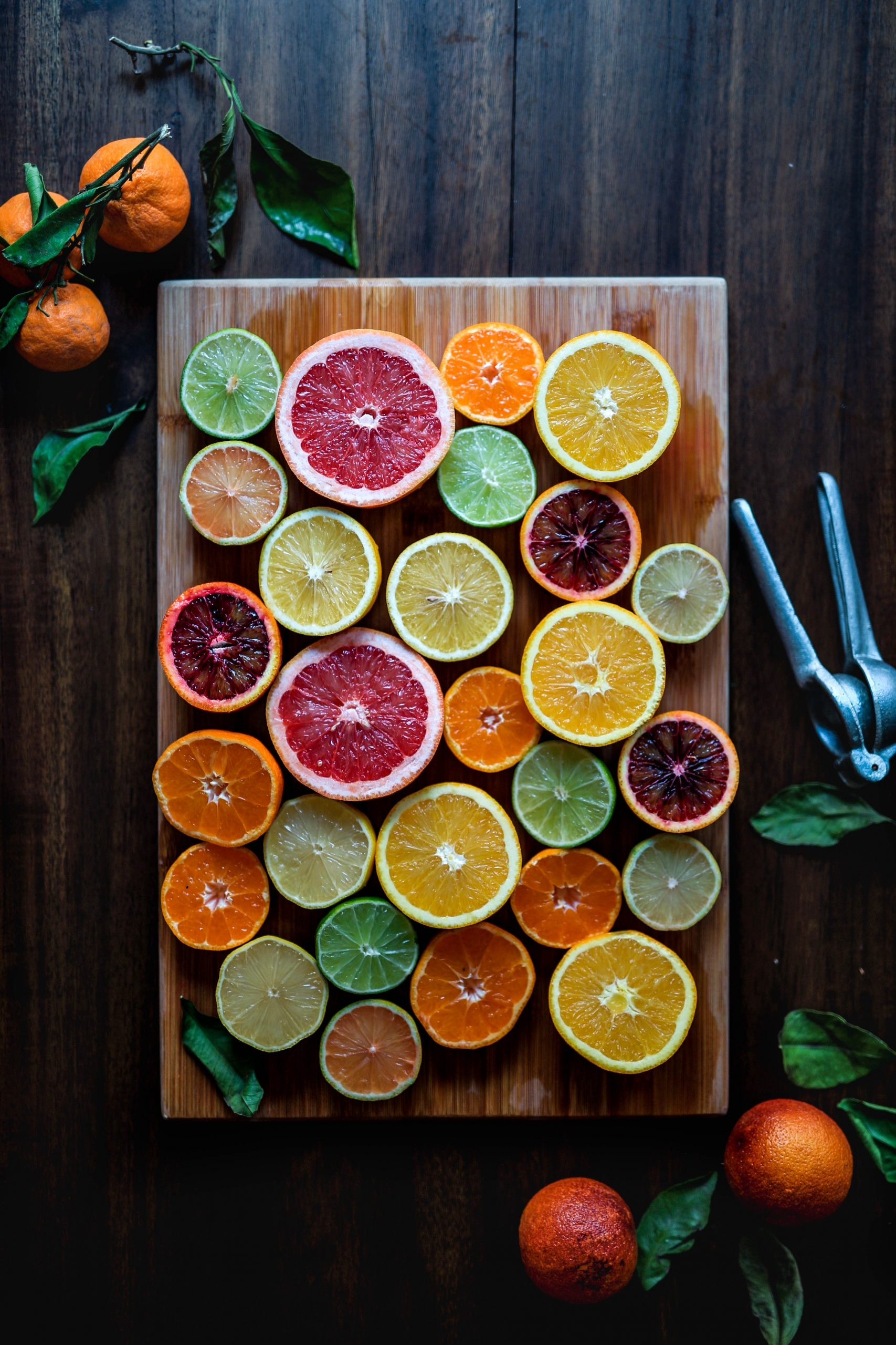 Different kinds of oranges on a cutting board