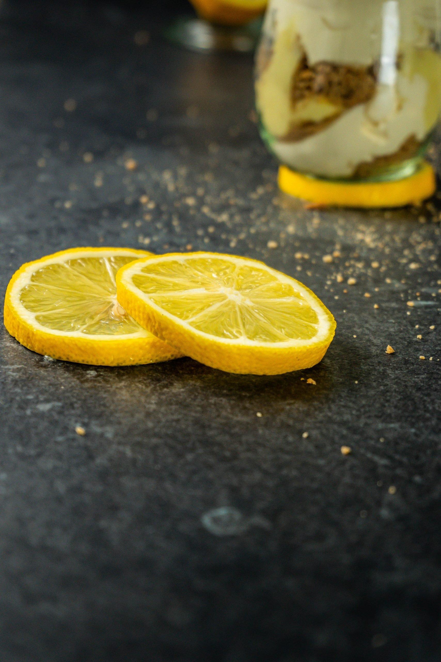 Lemon slices, photographed on a dark background