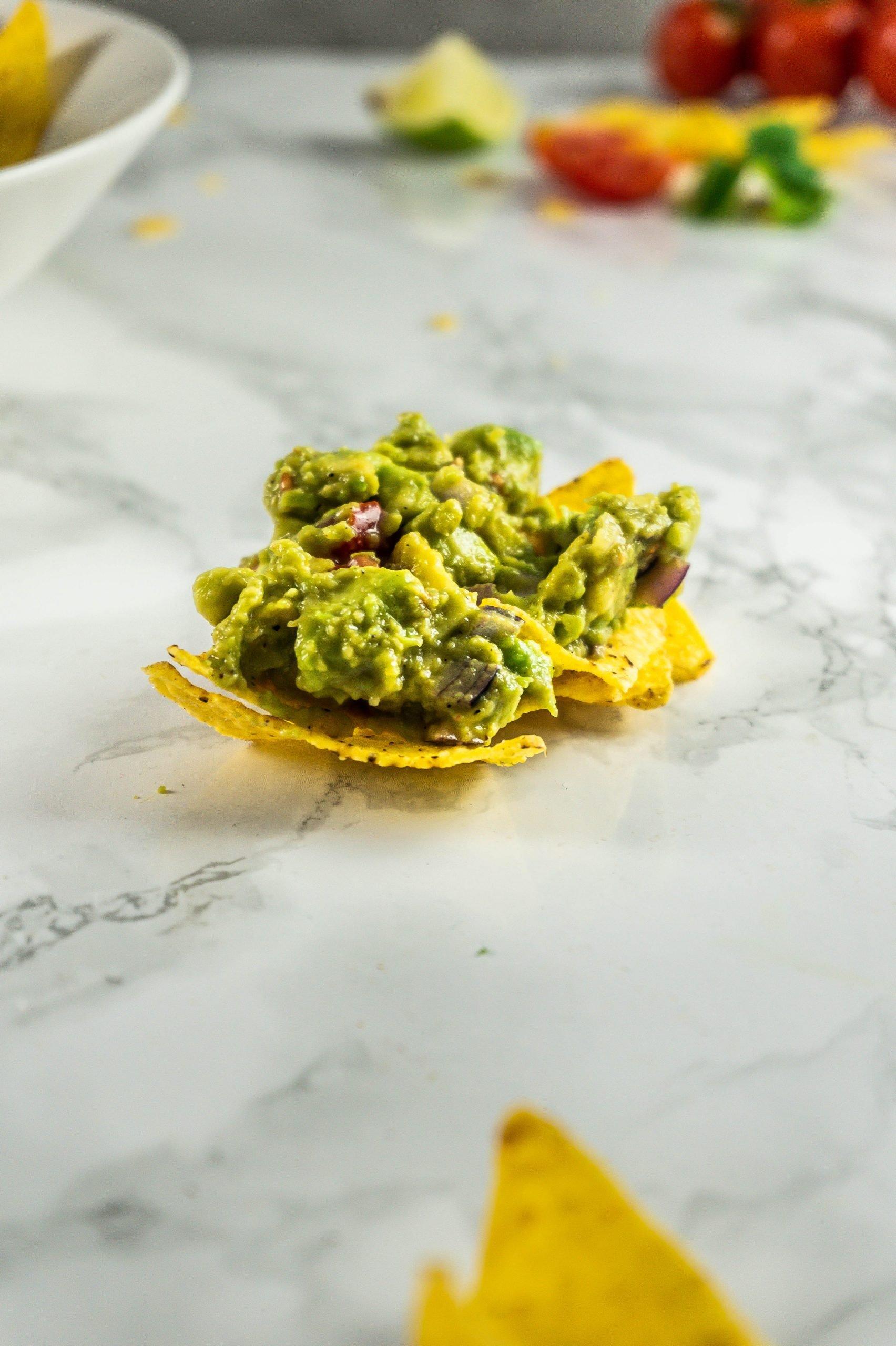 My Dear Friend's Best Guacamole on two tortilla chips