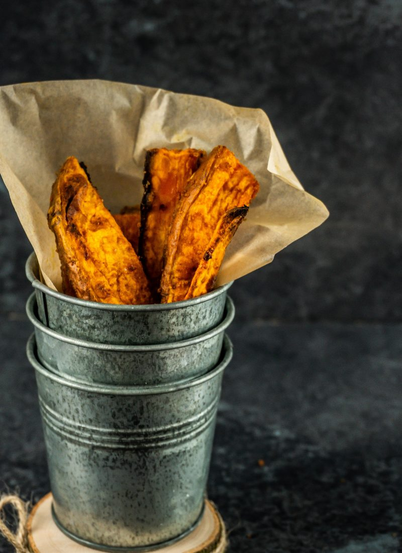 Sweet Potato Wedges in a metal cup being stacked up