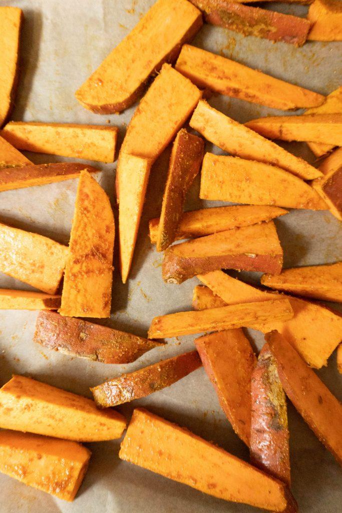 Sweet Potato Wedges on a baking tray before baking