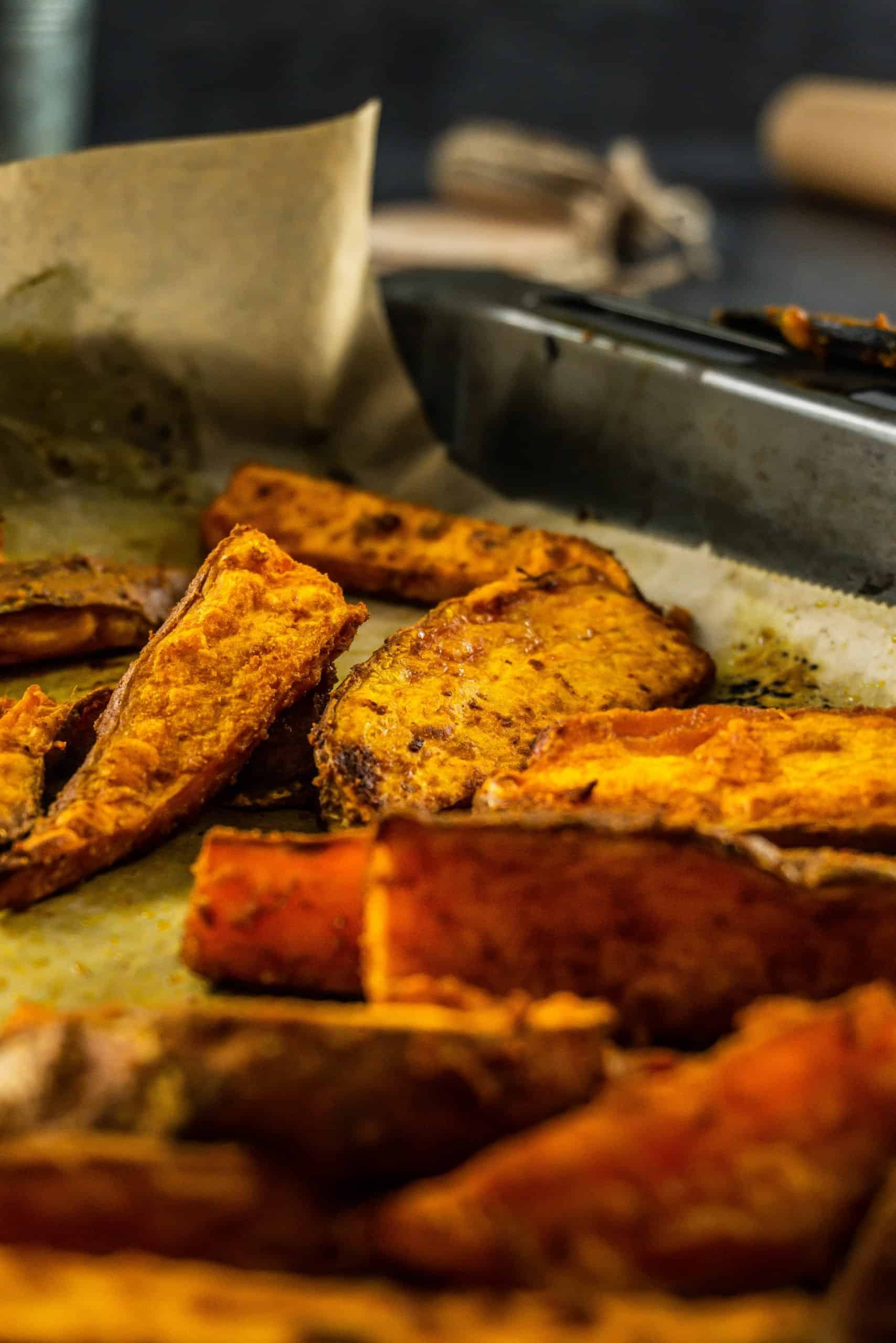 Sweet Potato Wedges on a baking tray after baking