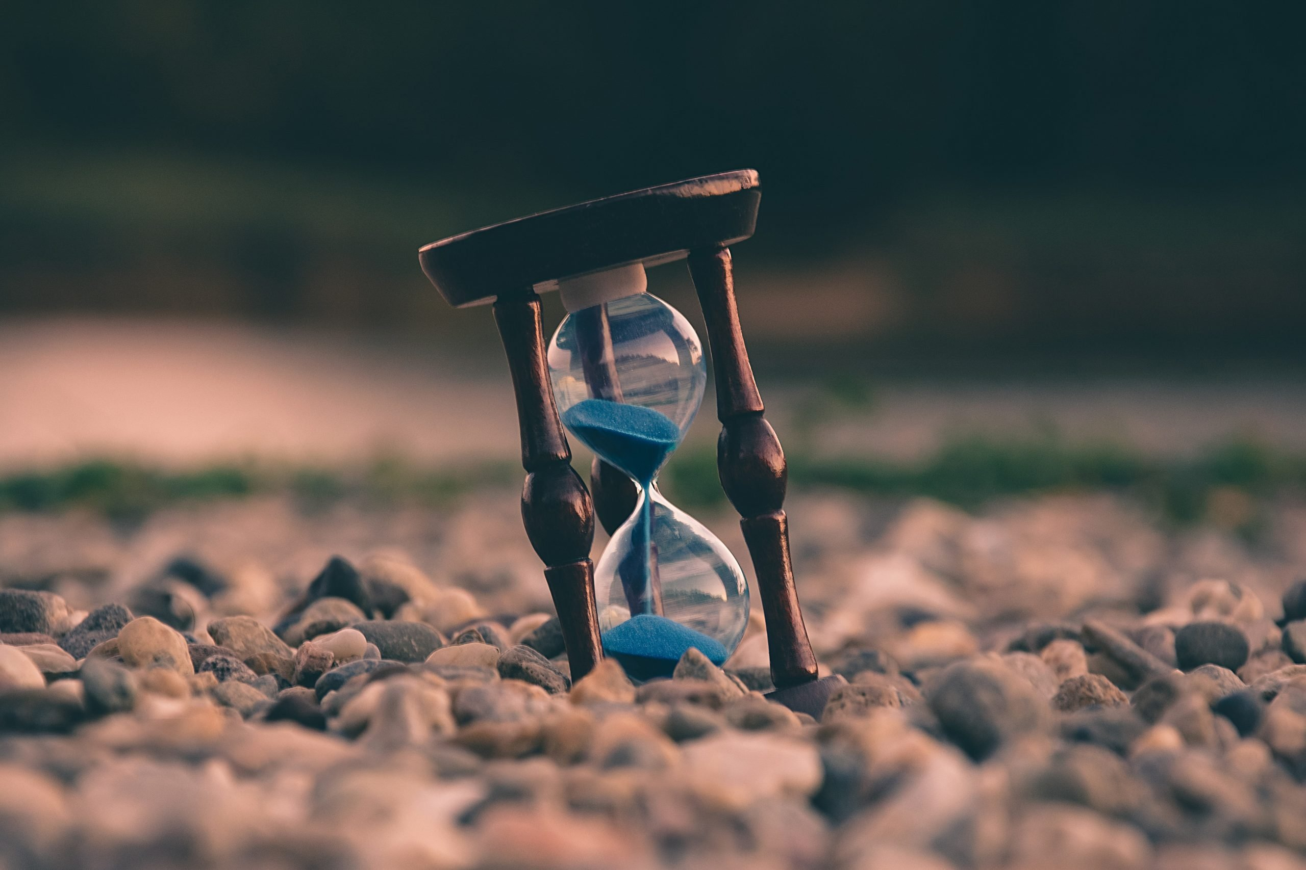 Hourglass on a stony beach