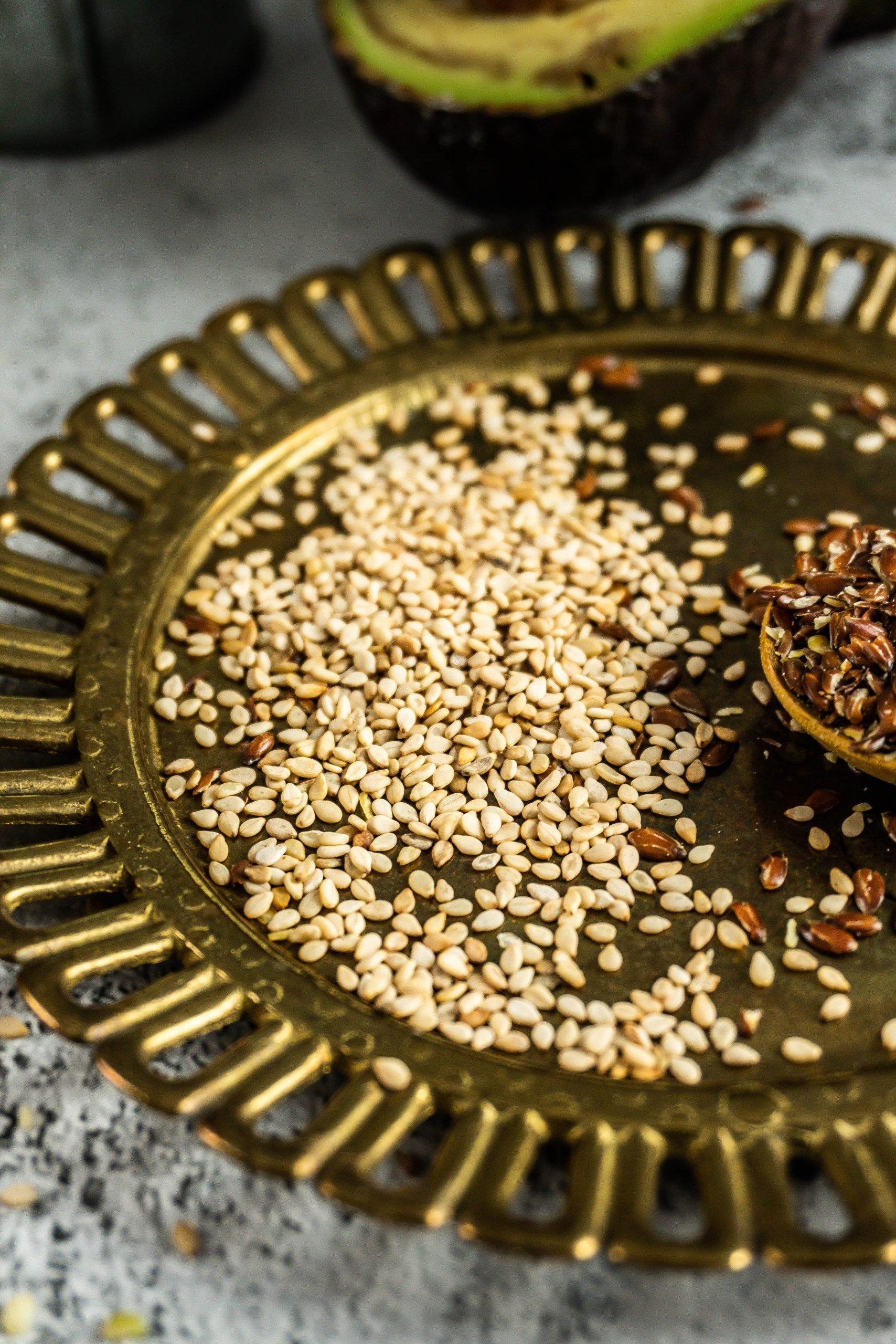 Sesame seeds on a golden plate