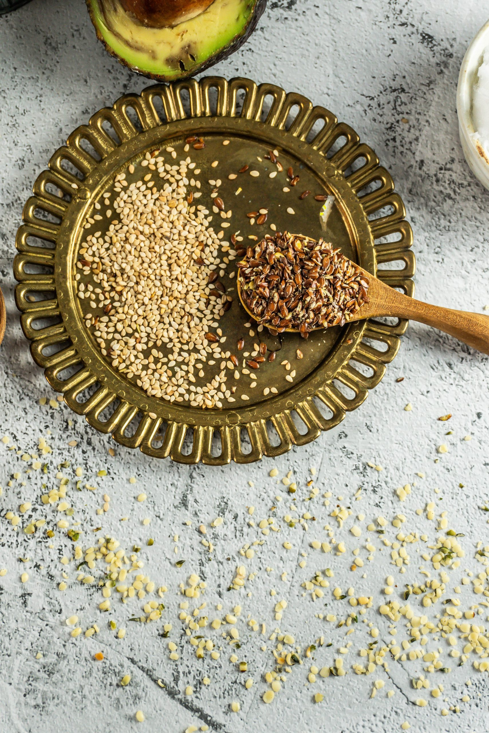 Sesame and flax seeds on a small wooden spoon